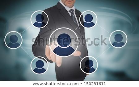 mature business man pressing social media icon stock photo © hasloo