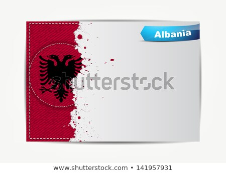stitched albania flag with grunge paper frame for your text stock photo © maxmitzu