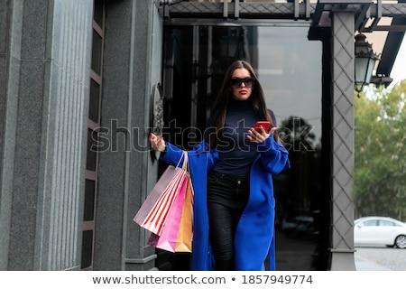 Beautiful woman near shop show-window Stock photo © ssuaphoto