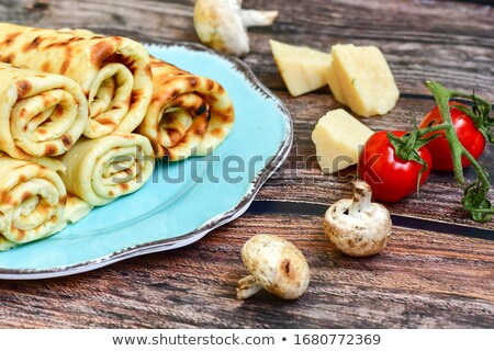 salty pancakes with mushrooms stock photo © doupix