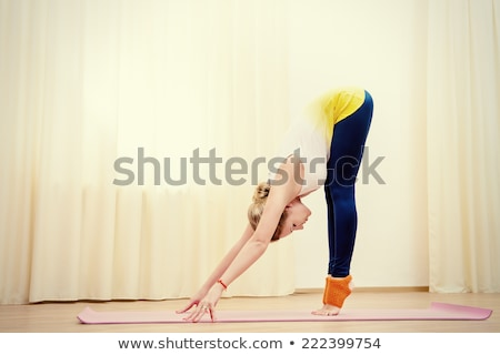 Slender fit young beauty. Stock photo © lithian