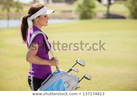 girl carrying golf bag stock photo © zzve