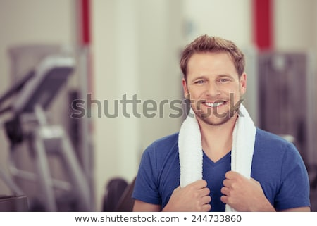 young man with a towel posing stock photo © stepstock