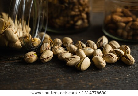 Salty nuts of roasted pistachio on an old wooden table. Stock photo © Kirill_M