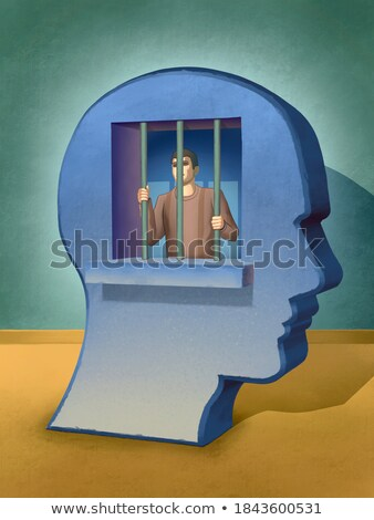 Caged mind inside a head silhouette foto stock © adrian_n