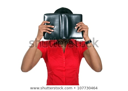 woman hiding her face behind a leather bound book stock photo © photography33