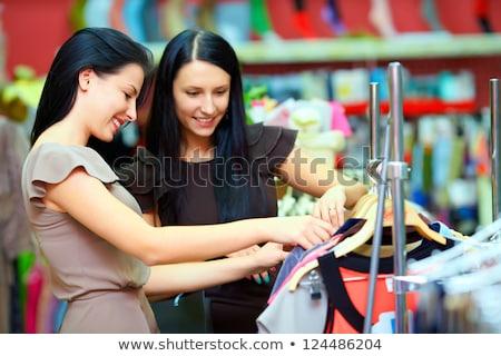 csinos · barna · hajú · mosolyog · kamera · ruházat · sín - stock fotó © hasloo