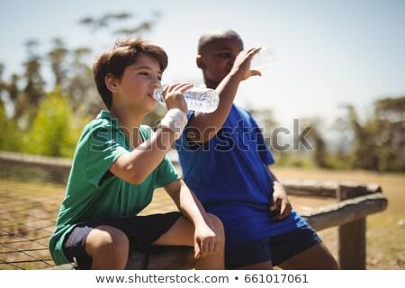 Kid питьевой вода в бутылках питьевая вода бутылку небе Сток-фото © Kzenon