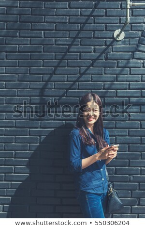 Smiling woman at day near brick wall Stock photo © vetdoctor