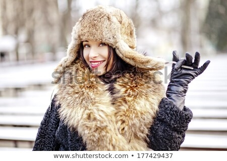 Joyfull russian woman in fur hat and coat stock photo © Kor