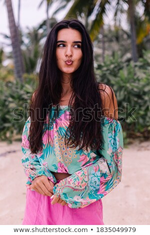 Pretty brunette in the tropical forest Stock photo © konradbak
