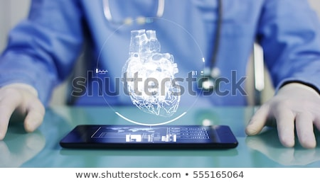 Medical doctor examining human eye Stock photo © HASLOO