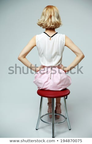 back view portrait of young blond woman over gray background stock photo © deandrobot