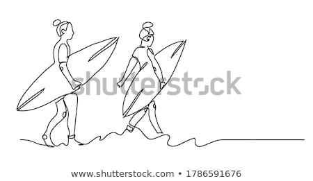 Szörfös lány gyönyörű tengerpart magasra tart szörfdeszka Stock fotó © iko