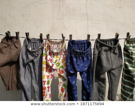 Stockfoto: Old Clothespin Under Blue Sky I