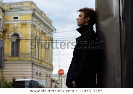 Confident attractive man standing waiting Stock photo © juniart