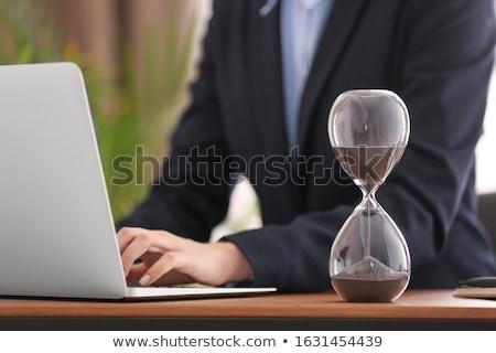 woman hand with sandglass Stock photo © dolgachov
