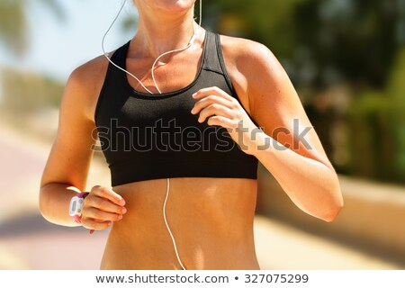 Jogger Running In Sportsbra With Music Earphones  Stock photo © Maridav