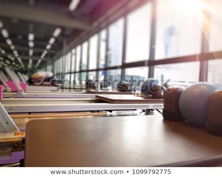Pilates nő evezés csetepaté testmozgás edzés Stock fotó © lunamarina