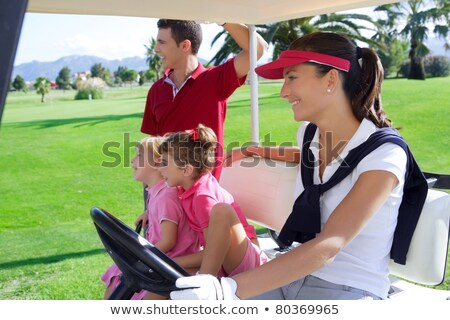 Golf course young people group buggy green field Stock photo © lunamarina
