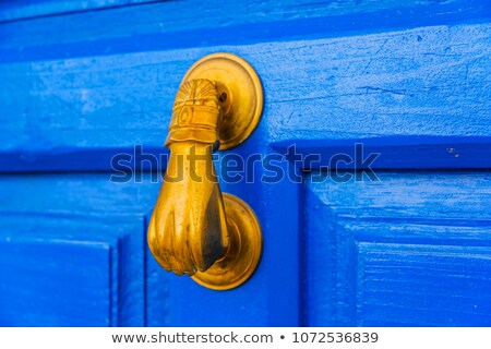 Detail of hand shaped door knocker Stock photo © backyardproductions