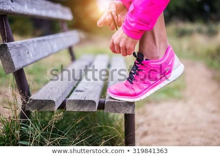 młodych · atrakcyjna · kobieta · uruchomić · dziewczyna · drzewo · uśmiech - zdjęcia stock © Paha_L
