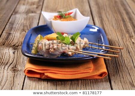 Chicken skewers  and Romesco sauce Stock photo © Digifoodstock