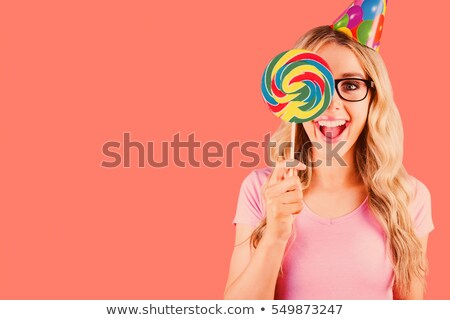 Stockfoto: Composite Image Of Portrait Of A Hipster Hiding Herself Behind A