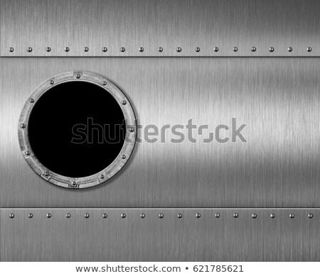 Brushed metal background with porthole Stock photo © kjpargeter