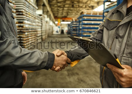 Worker and engineer handshake in factory Stock photo © Kzenon