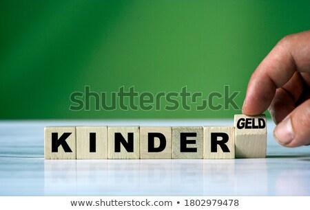 Benefit - an inscription from children's blocks Stock photo © CaptureLight