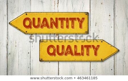 Direction signs on a wooden wall - Quantity or Quality Stock photo © Zerbor