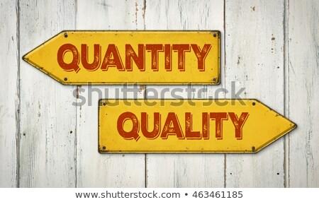 Direction signes bois mur quantité qualité Photo stock © Zerbor