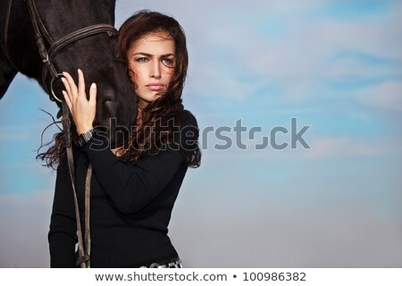 Beautiful young woman posing with a horse Stock photo © konradbak
