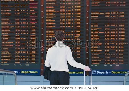 man looking at departure board in the airport stock photo © rastudio