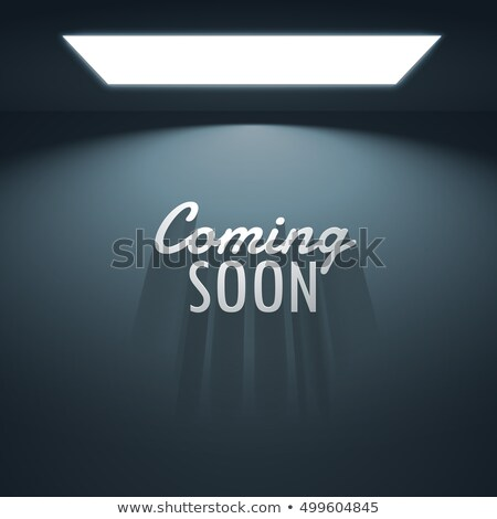 coming soon text with shadows placed under glowing lamp stock photo © sarts