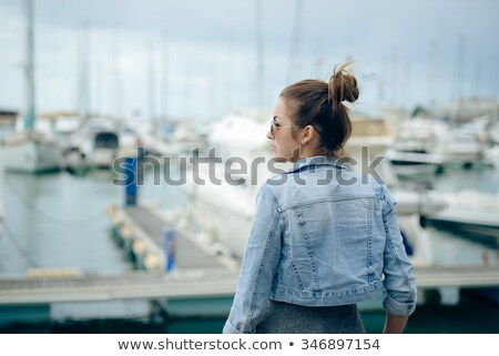 Widok z tyłu zdjęcie młodych zdumiewający kobieta jacht Zdjęcia stock © deandrobot