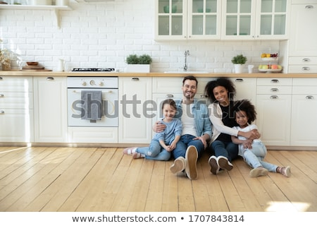 Cheerful multiethnic young couple renovating home and resting Stock photo © deandrobot