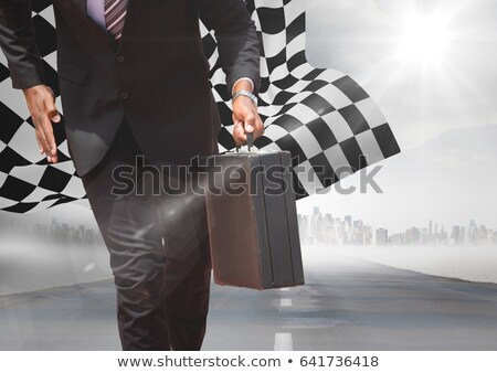 business man lower body with briefcase on road with skyline and checkered flag stock photo © wavebreak_media