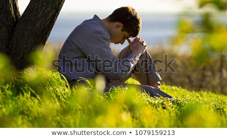 man is praying on his knees prayer to god stock photo © maryvalery