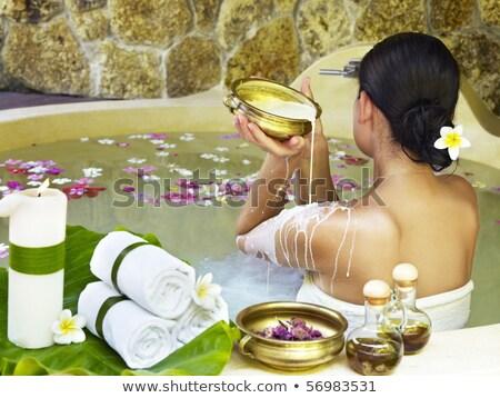 beauty young brunette girl in bath, taking milk spa  Stock photo © iordani
