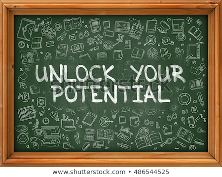 Hand Drawn Unlock Your Potential on Green Chalkboard. Stock photo © tashatuvango