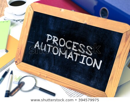process automation handwritten by white chalk on a blackboard stock photo © tashatuvango