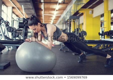Woman Doing Push Ups On Swiss Ball At Gym stock photo © monkey_business