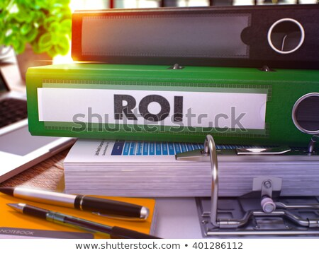 green office folder with inscription roi stock photo © tashatuvango