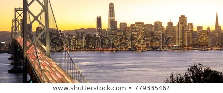 san francisco downtown and bay bridge in the golden hours stock photo © yhelfman