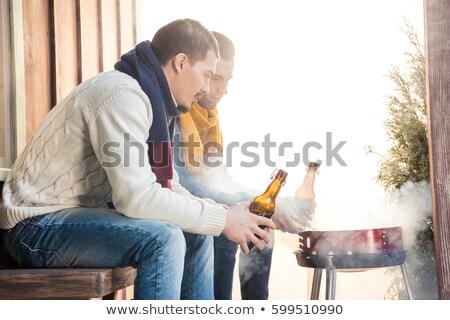 Oldalnézet férfiak sör üvegek veranda néz Stock fotó © LightFieldStudios