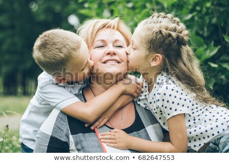 grandma and grandchildren hugging Stock photo © IS2