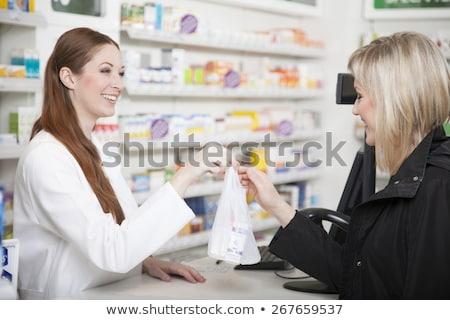 Pharmacist handing over prescription Stock photo © IS2