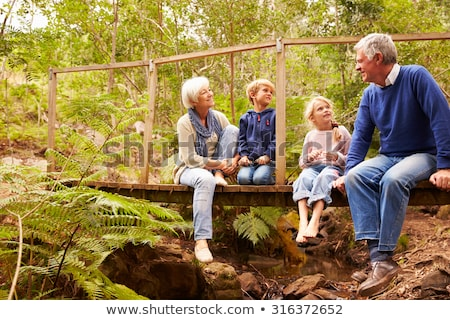 Grandparents and grandchildren exploring Stock photo © IS2